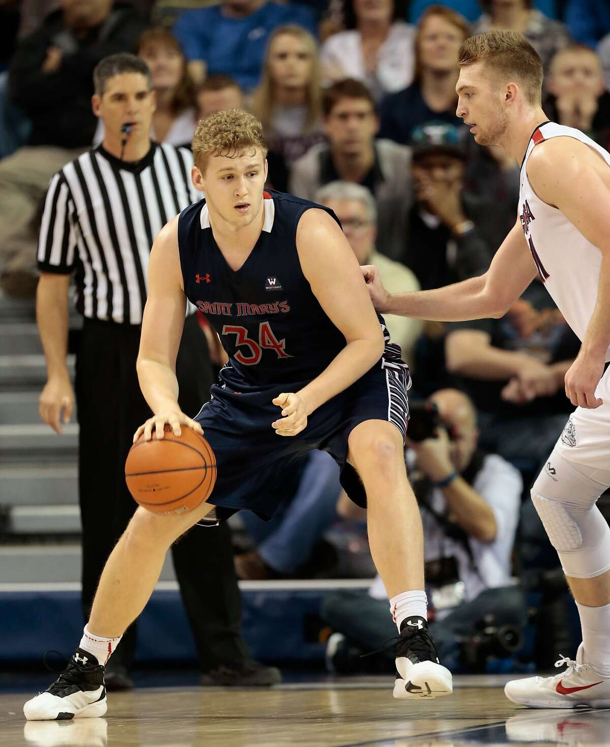 SPOKANE, WA - FEBRUARY 20: Jock Landale #34 of the Saint Mary's Gaels controls the ball against Domantas Sabonis #11 of the Gonzaga Bulldogs in the second half of the game at McCarthey Athletic Center on February 20, 2016 in Spokane, Washington. Saint Mary's defeated Gonzaga 63-58. (Photo by William Mancebo/Getty Images)