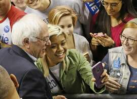 Democratic presidential candidate, Sen. Bernie Sanders, I-Vt., left poses for a selfie with a supporter after a speach in Norfolk, Va., Tuesday, Feb. 23, 2016.  (AP Photo/Steve Helber)