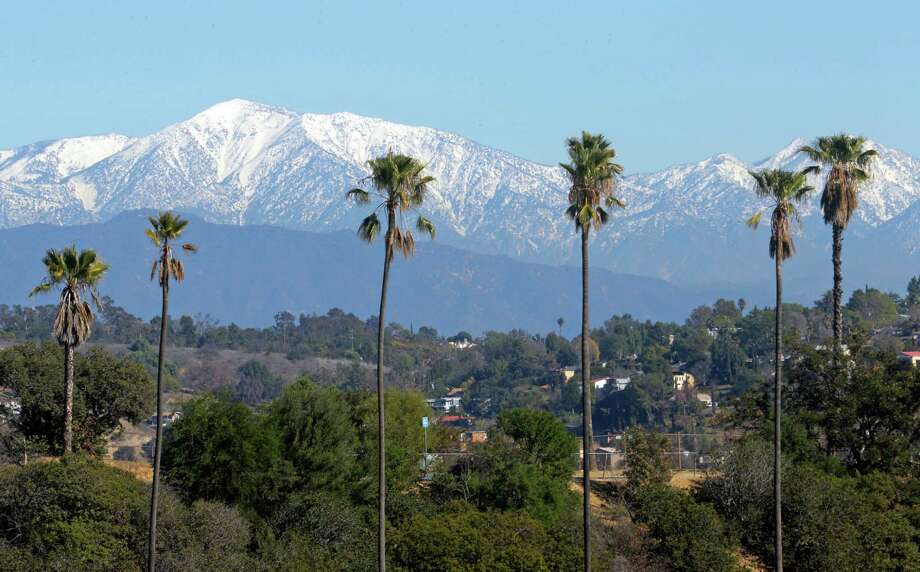 FILE - This Jan. 12, 2016 file photo shows the snow-capped San Gabriel Mountains, with Mount Baldy the highest peak at the left, seen from Chinatown near downtown Los Angeles. Authorities have closed trails at Baldy following the death of the second hiker in a week. San Bernardino County sheriff's officials say 47-year-old Dong Xing Liu died Saturday, Feb. 6, 2016, after he slipped and fell in the Icehouse Saddle area.(AP Photo/Nick Ut, File) Photo: Nick Ut, STF / AP
