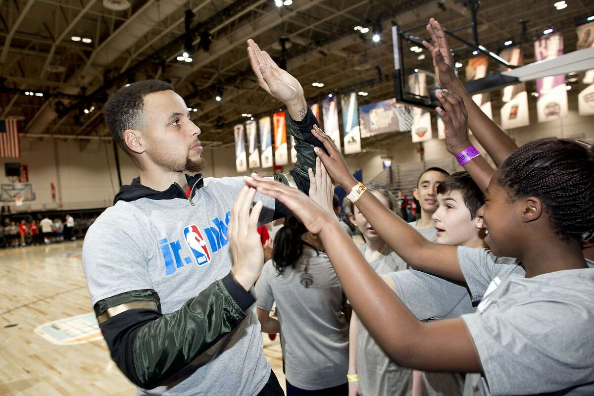 TORONTO, ON- FEBRUARY 12: NBA all-star Stephen Curry greeted kids from the Halton Catholic School district at the Enercare Centre in Toronto as part of the NBA all-star Junior NBA day festivities. (Lucas Oleniuk/Toronto Star via Getty Images)