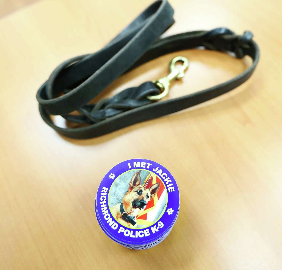 Jackie's leash and stickers are shown at a press conference at the Richmond Police Department.