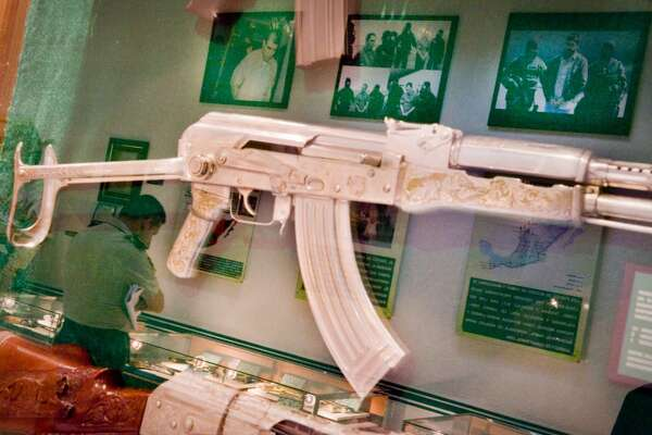 In Mexico City, the military has a museum used to train officials, diplomats, and cadets about the war on drugs.  An elaborately etched automatic weapon hangs on the wall.  Photographs of captured cartel members are reflected on the glass case.