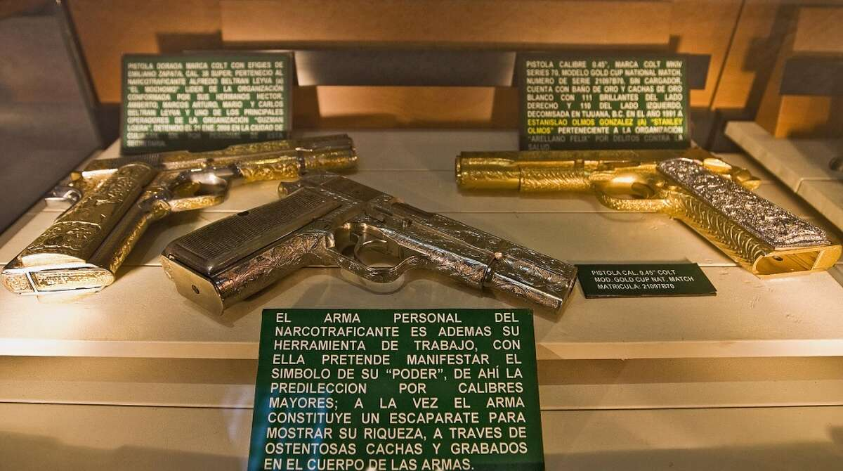 Gold-plated arms are on display at the Museum of Drugs of Mexico City.