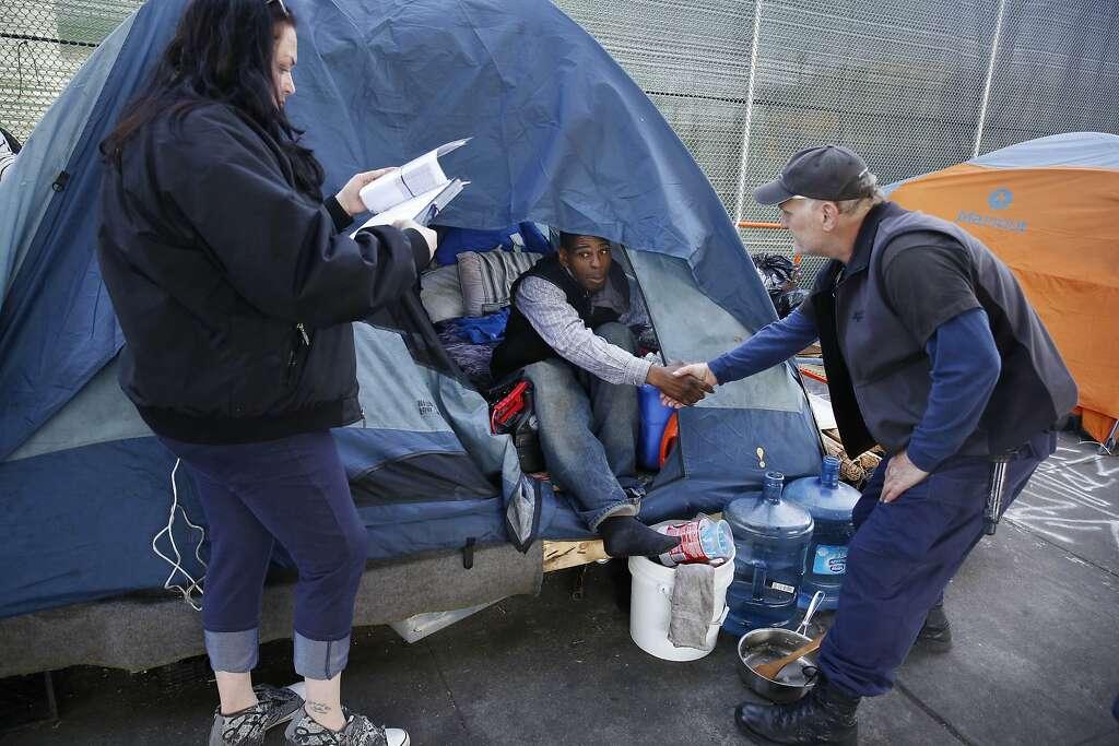 Ashante Jones (center) homeless resident shakes the hand of Kris Zeitz (right & Tent dwellers leaving Division Street as deadline looms - SFGate