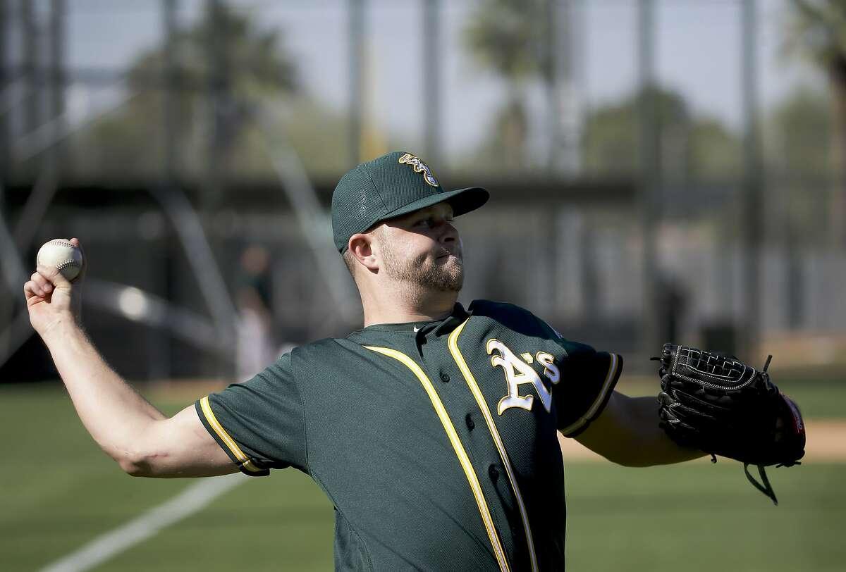Oakland Athletics starting pitcher Jesse Hahn throws during spring training baseball practice in Mesa, Ariz., Sunday, Feb. 21, 2016. (AP Photo/Chris Carlson)