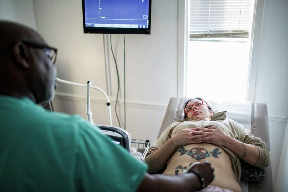 Dr. Willie Parker performs an ultrasound on Ashley Garza prior to her abortion at Reproductive Health Services in Montgomery, Ala., earlier this month. Parker travels between three different clinics. Photo: MELISSA GOLDEN, STR / NYTNS