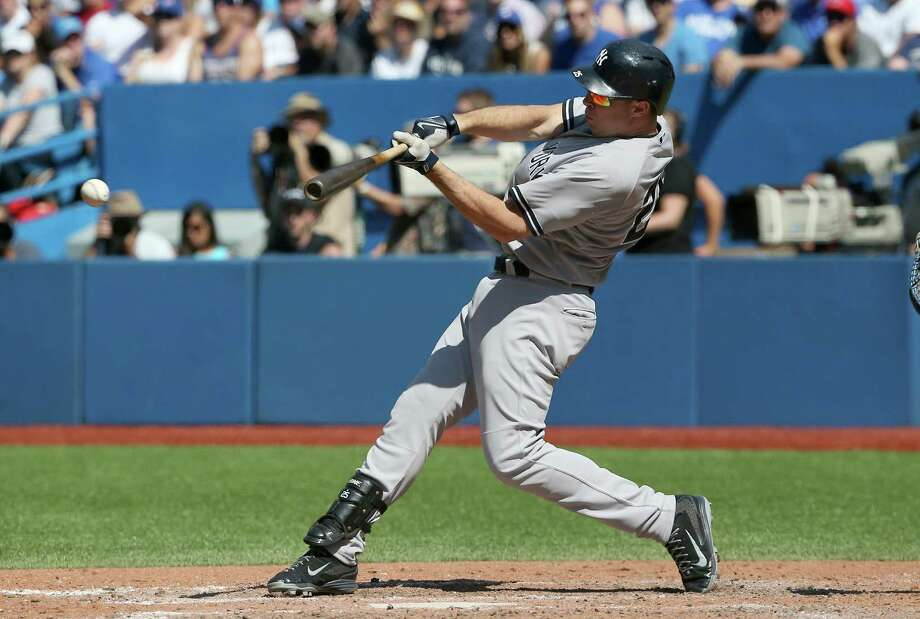 TORONTO, CANADA - AUGUST 15: Mark Teixeira #25 of the New York Yankees hits an RBI single in the eighth inning during MLB game action against the Toronto Blue Jays on August 15, 2015 at Rogers Centre in Toronto, Ontario, Canada. (Photo by Tom Szczerbowski/Getty Images) ORG XMIT: 538589941 Photo: Tom Szczerbowski / 2015 Getty Images