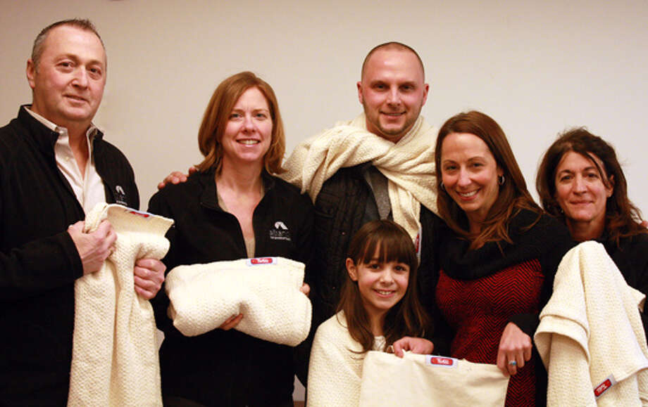 The Alliance for Positive Health received a special donation of more than 60 child-size blankets thanks to Fingerpaint and Twill.  These blankets will be given to children of clients in the next coming weeks through the Client Services program.  Twill has donated about 2,000 blankets since its start in late 2013. Pictured from left are Bill Faragon, Executive Director Alliance for Positive Health; Sherry Piscitella, Director of  Client Services, Alliance for Positive Health; Jer Halloran,, Co-owner and CFO TWILL; .Bo Goliber, Community Relations Fingerpaint; Donna Vancavage, Director of Development & Marketing, Alliance for Positive Health; Maddie Goliber. (Submitted photo)