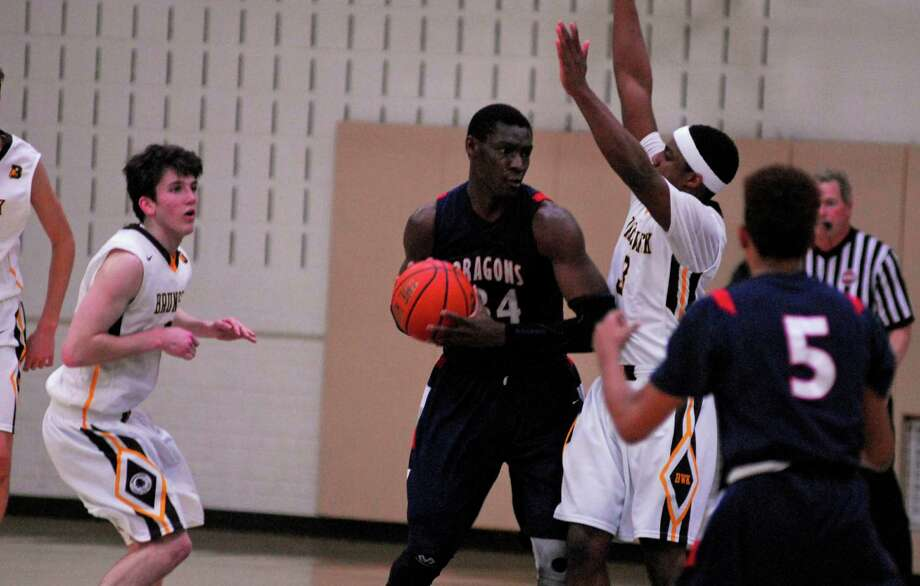 Greens Farms Academy's Sunday Okeke, center, works in the post during a boys basketball game against Brunswick on Wednesday, February 24th, 2016. Photo: Ryan Lacey/Staff Photo / Westport News Contributed