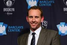 NEW YORK, NY - FEBRUARY 19: Sean Marks, General Manager of the Brooklyn Nets, poses with a ball after a press conference announcing title at Barclays Center on February 19, 2016 in the Brooklyn borough of New York City. NOTE TO USER: User expressly acknowledges and agrees that, by downloading and or using this photograph, User is consenting to the terms and conditions of the Getty Images License Agreement. (Photo by Elsa/Getty Images)