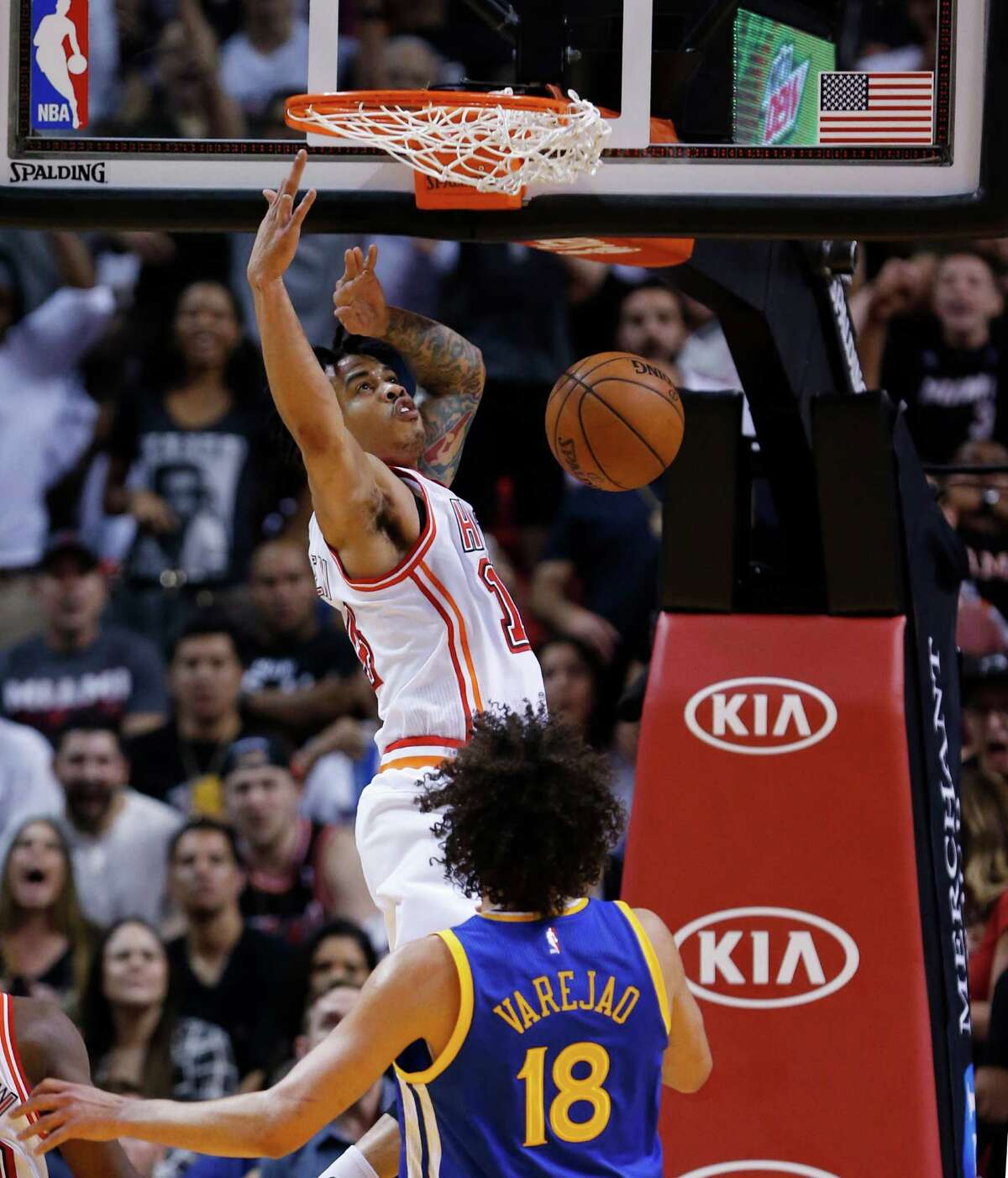 Miami Heat guard Gerald Green dunks against Golden State Warriors center Anderson Varejao (18) during the first half of an NBA basketball game Wednesday, Feb. 24, 2016, in Miami.
