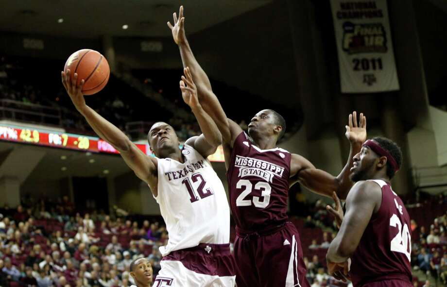 Texas A&M's Jalen Jones (12) makes a layup against Mississippi State's Travis Daniels (23) during the first half of an NCAA college basketball game, Wednesday, Feb. 24, 2016, in College Station, Texas.  (AP Photo/Sam Craft) Photo: Sam Craft, Associated Press / FR145148 AP