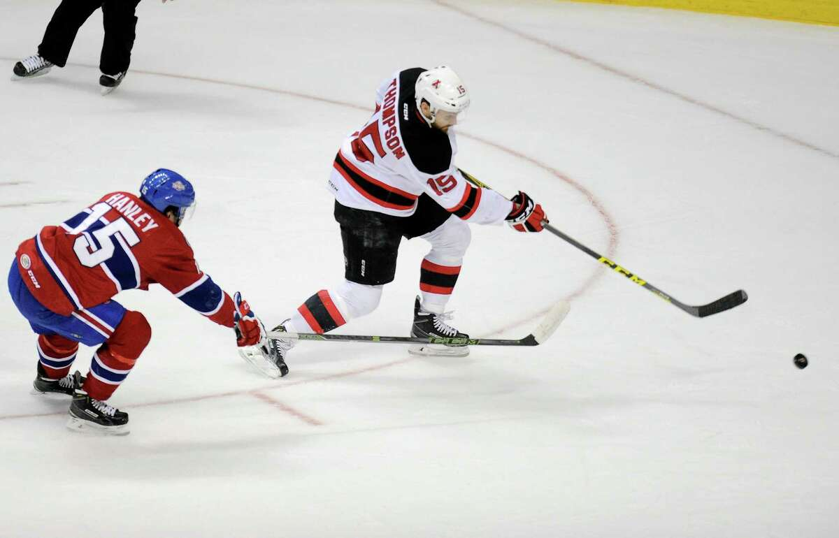Albany Devils' Paul Thompson (15) skates past St. John's IceCaps' Joel Hanley (15) scoring a goal during the first period of an AHL hockey game in Albany, N.Y., Wed., Feb. 24, 2016. (Hans Pennink / Special to the Times Union) ORG XMIT: HP101
