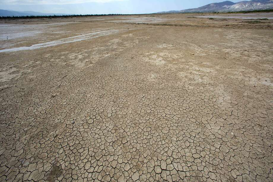 This Feb. 20, 2016 photo shows the dry, cracked lakebed of Trou Caiman, in Croix-des-Bouquets, Haiti. A drought worsened by the El Nino weather phenomenon has driven Haitians who were already barely getting by on marginal farmland deeper into misery. Photo: Dieu Nalio Chery, Associated Press