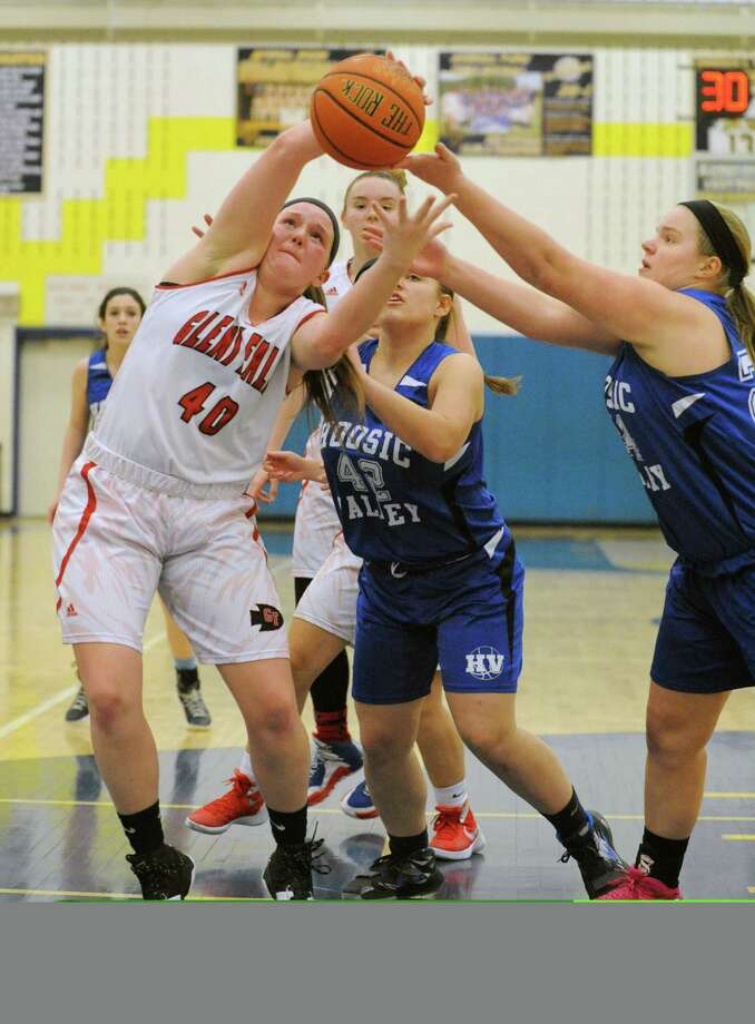 Glens Falls Taylor Scarincio grabs a defensive rebound during their Class B girls' hoops semifinals game against Hoosic Valley on Wednesday Feb. 24, 2016 in Averill Park, N.Y. (Michael P. Farrell/Times Union) Photo: Michael P. Farrell / 10035548A