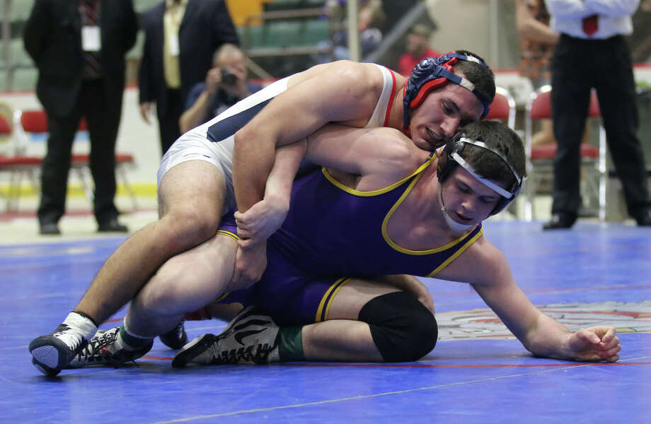 Ballston's Tyler Barnes, bottom, wrestles to victory over Schenectady's Collin Derboghassian at 170 during the Section II division I state qualifier at the Glens Falls Civic Center Sunday, February 14, 2016. (Ed Burke/Special to The Times Union)