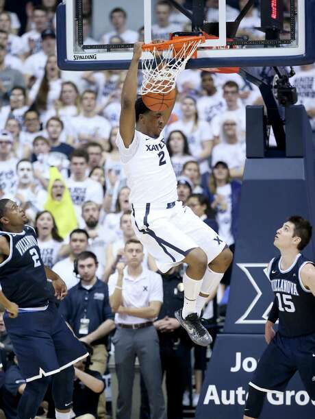 James Farr jams over Ryan Arcidiacono as Xavier soared to its first Big East win over Villanova. Photo: Andy Lyons, Staff / 2016 Getty Images