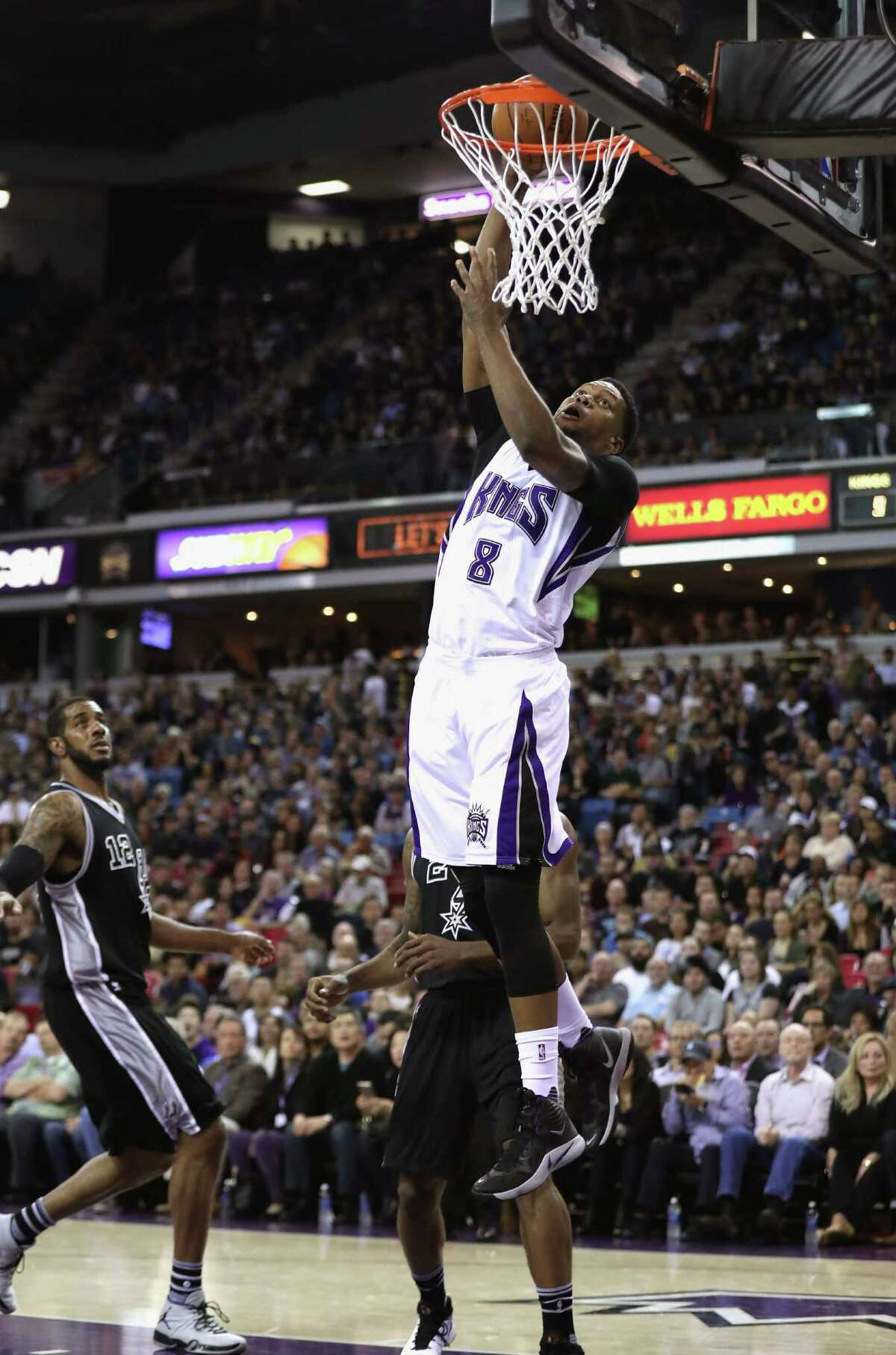 SACRAMENTO, CA - FEBRUARY 24: Rudy Gay #8 of the Sacramento Kings goes up for a dunk against the San Antonio Spurs at Sleep Train Arena on February 24, 2016 in Sacramento, California. NOTE TO USER: User expressly acknowledges and agrees that, by downloading and or using this photograph, User is consenting to the terms and conditions of the Getty Images License Agreement.