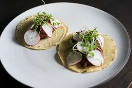 Tacos with chicken, mole and pulled pork are served during happy hour at Restaurant 1833 in Pacific Grove, Calif. on Friday, February 19, 2016. Restaurant 1833 has one of the best social hours in the peninsula.