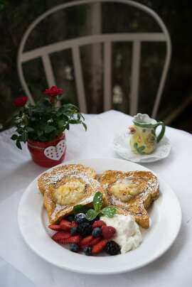 The french toast at the Red House is served with fruit in Pacific Grove, Calif. on Saturday, February 20, 2016. The Red House is a popular place for brunch.