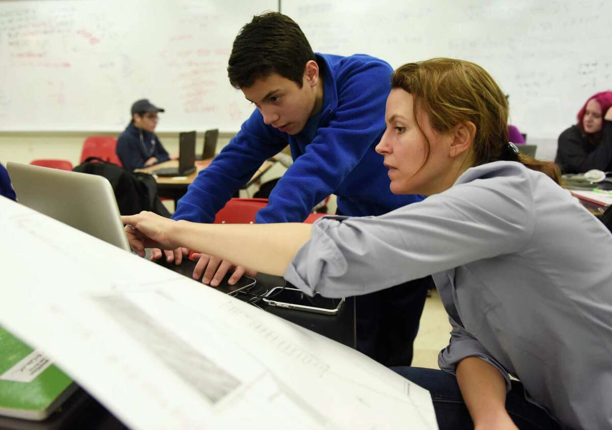 STEM teacher Sarah Goldin helps sophomore Rich Consiglio with a project in the Innovation Lab at Greenwich High School.
