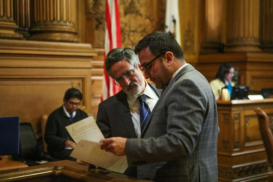 Supervisor Aaron Peskin looks over paperwork with Supervisor David Campos, during a Board of Supervisors meeting at City Hall, in San Francisco, California on Tuesday, February 23, 2016. Photo: Gabrielle Lurie, Special To The Chronicle