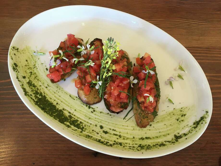 Bruschetta and salmon pasta in a caper cream sauce at Edera Osteria Enoteca. Photo: Edmund Tijerina / San Antonio Express-News