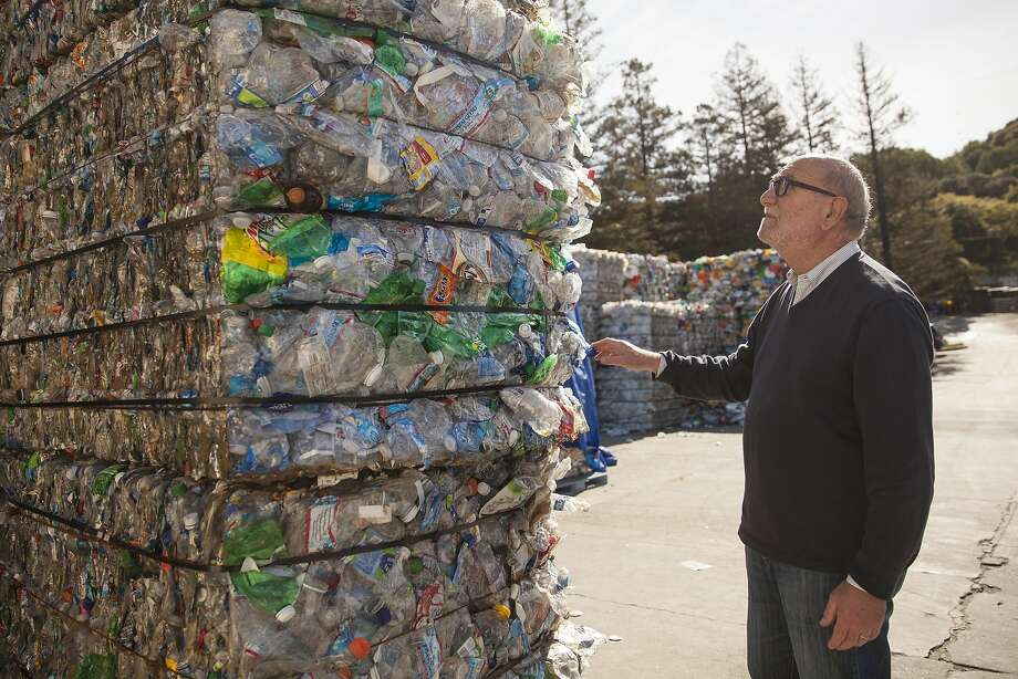 Paul Tasner , founder and CEO of PulpWorks surveys bails of recycled plastic bottles at the Marin Sanitary Services - Recycling Center in San Rafael, California, USA 23 Feb 2016.