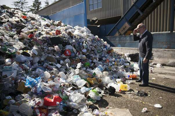 Paul Tasner , founder and CEO of PulpWorks surveys a mixed pile of unsorted recycled plastics at the Marin Sanitary Services - Recycling Center in San Rafael, California, USA 23 Feb 2016. (Peter DaSilva/Special to The Chronicle)