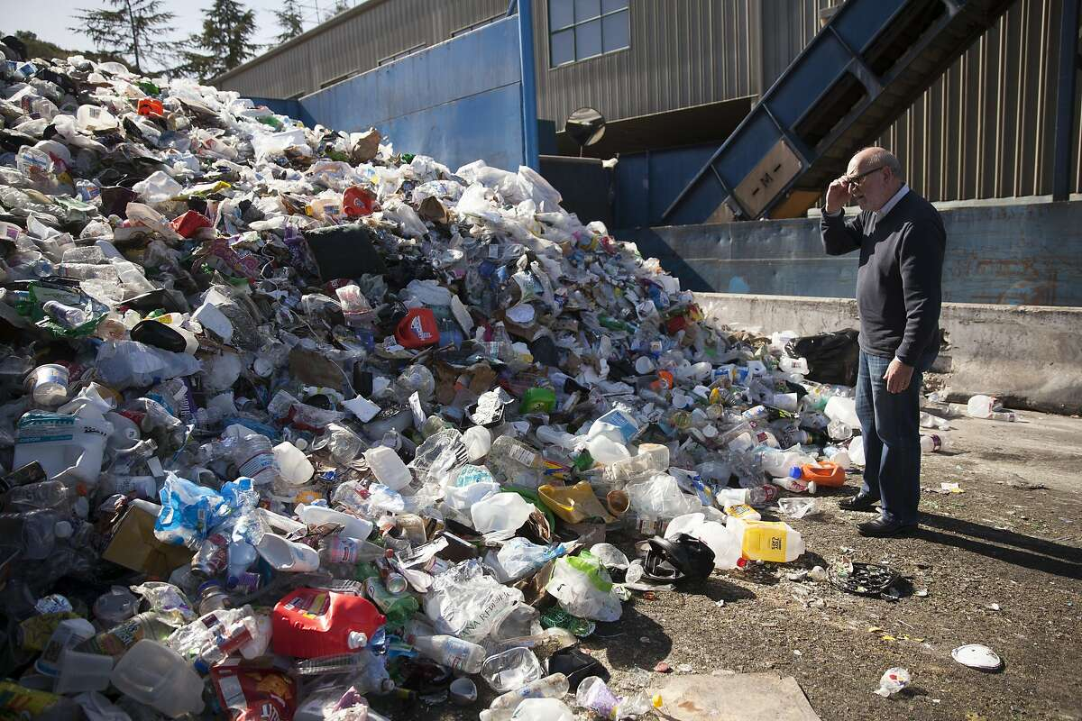 Paul Tasner, founder and CEO of PulpWorks surveys a mixed pile of unsorted recycled plastics at the Marin Sanitary Services - Recycling Center in San Rafael.