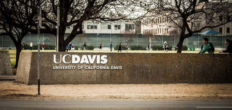 In this file photo, the UC Davis logo is seen with a soccer game and bike riders in the background. University of California at Davis. Davis, California. Taken February 2, 2015. Photo: Joseph DeSantis, Getty / This image is subject to copyright.