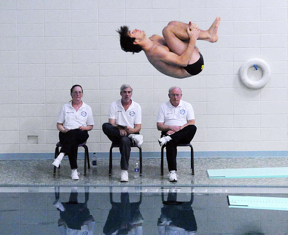Trumbull's Cameron Hutchins dives during the FCIAC Diving Championships at Westhill High School in Stamford, Conn., Wednesday, Feb. 24, 2016. Photo: Bob Luckey Jr. / Hearst Connecticut Media / Greenwich Time