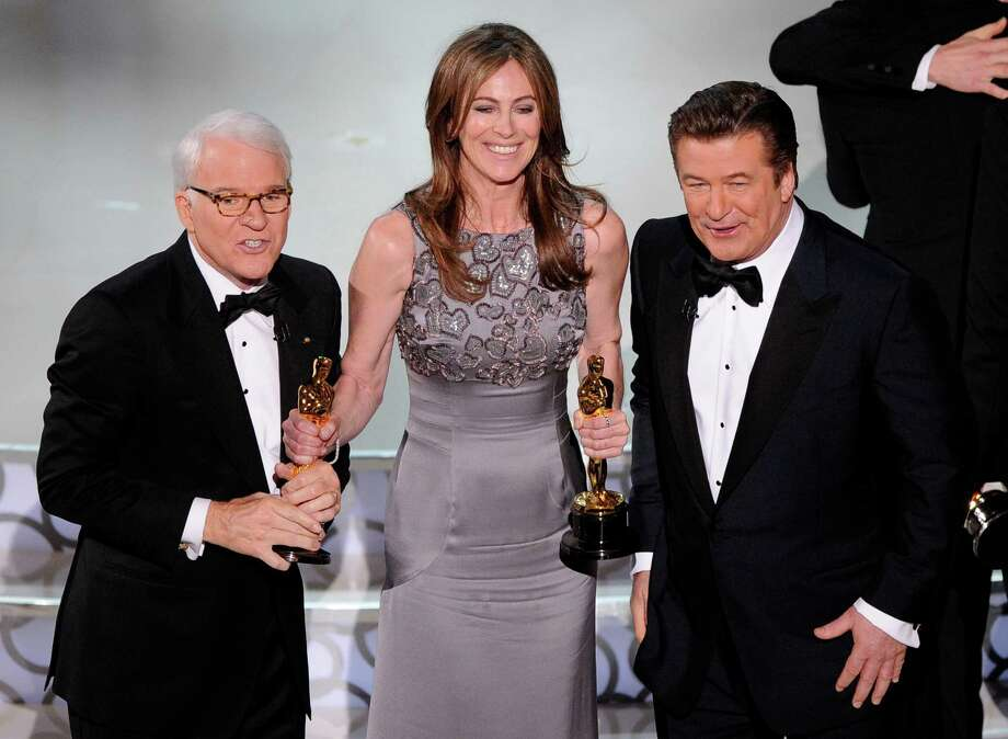 """FILE - In this March 7, 2010 file photo, director Kathryn Bigelow, center, holds her Oscars for best motion picture of the year and best achievement in directing for """"The Hurt Locker"""" with hosts Alec Baldwin, right, and Steve Martin at the conclusion of the 82nd Academy Awards in Los Angeles. Bigelow was the first and only woman to win an Oscar for best director. (AP Photo/Mark J. Terrill, File) Photo: Mark J. Terrill, STF / AP"""