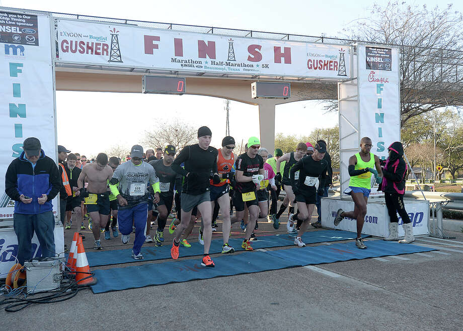 Half and full marathon runners take off from the starting line during the sixth annual Exygon and Baptist Hospitals Gusher Marathon Saturday in Beaumont. Photo taken Saturday, March 7, 2015 Kim Brent/The Enterprise Photo: Kim Brent / Beaumont Enterprise