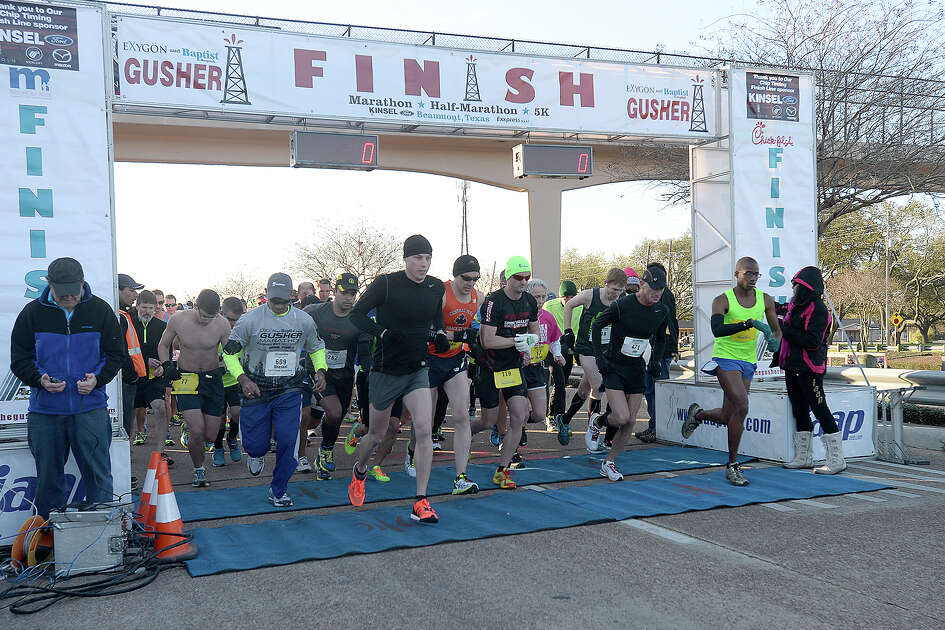 Half and full marathon runners take off from the starting line during the sixth annual Exygon and Baptist Hospitals Gusher Marathon Saturday in Beaumont. Photo taken Saturday, March 7, 2015 Kim Brent/The Enterprise