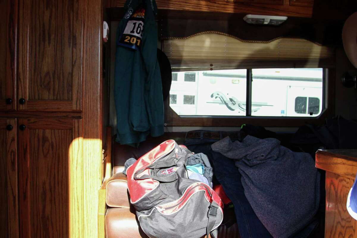 Clayton Hass, of Terrell, Texas, resides in this horse trailer with living quarters, offering a bare-bones approach to living on the road.