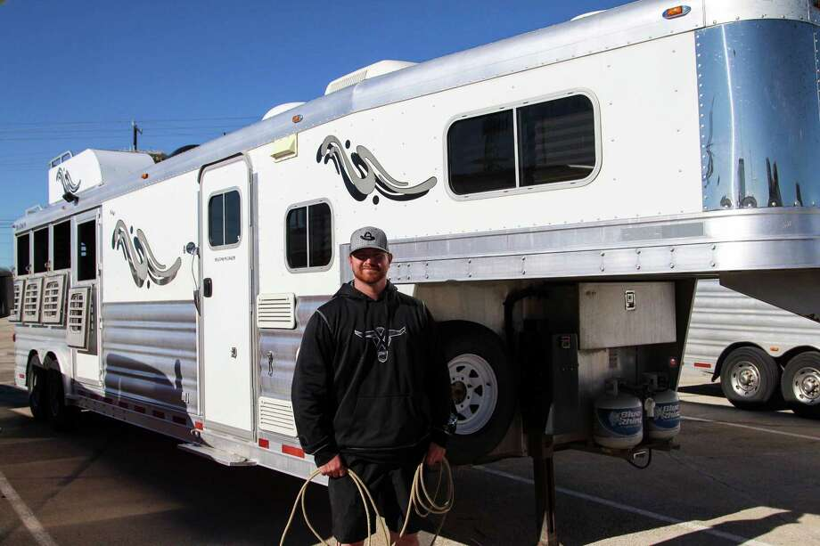 Clayton Hass, of Terrell, Texas, resides in this horse trailer with living quarters, offering a bare-bones approach to living on the road. Photo: Tyler White/SAEN
