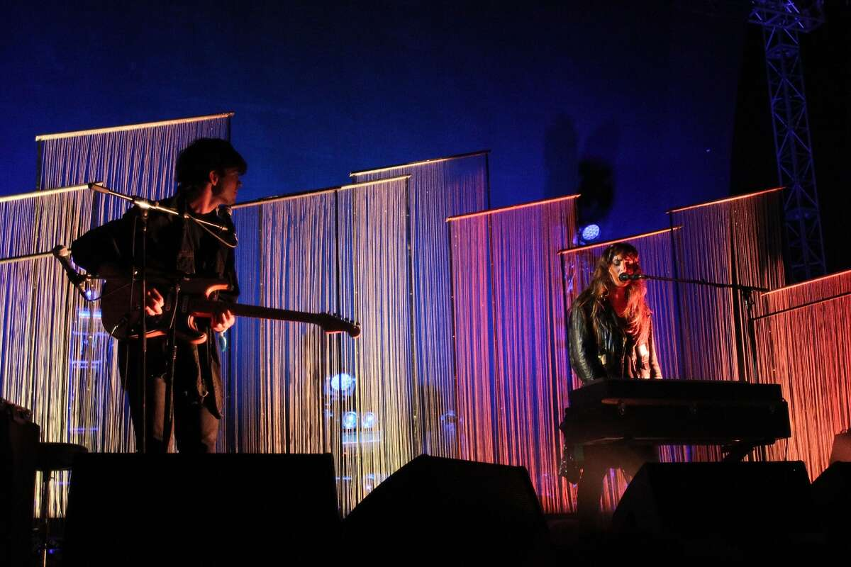 (L-R) Musicians Alex Scally, Victoria Legrand of Beach House perform onstage during day 2 at the 10th Annual FYF Music Festival at Los Angeles Historical Park on August 25, 2013 in Los Angeles, California. (Photo by Jonathan Leibson/WireImage)
