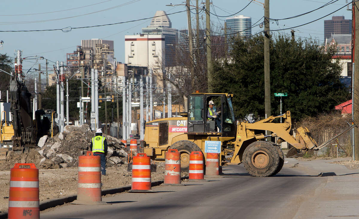 Road construction takes place along Harrisburg on Feb. 8.