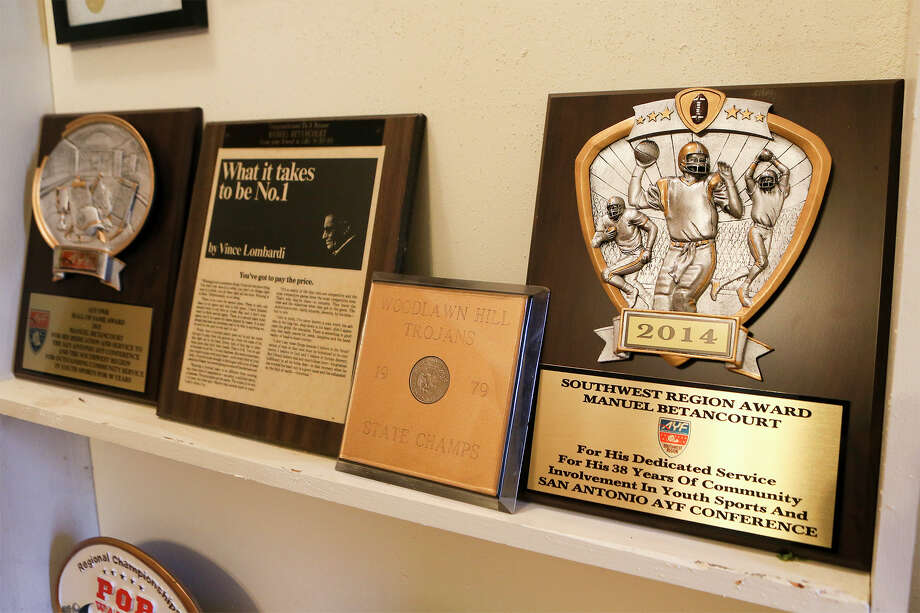 A sampling of the memorabilia and awards Manuel Betancourt has collected from coaching youth sports in San Antonio.  Betancourt, who has coached locally since 1967, was recently inducted into the American Youth Football Hall of Fame.  MARVIN PFEIFFER/ mpfeiffer@express-news.net Photo: Marvin Pfeiffer, Staff / San Antonio Express-News / Express-News 2016