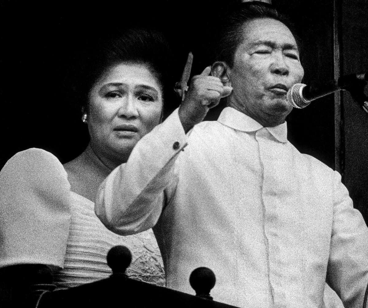 Ferdinand Marcos addresses a crowd of supporters from the balcony of the presidential palace. His wife, Imelda Marcos, is on the verge of tears. A few hours later, they fled the Philippines. (Feb. 25, 1986.) Photo by Kim Komenich for the San Francisco Examiner. (Copyright, 2011, Bancroft Library/the University of California)