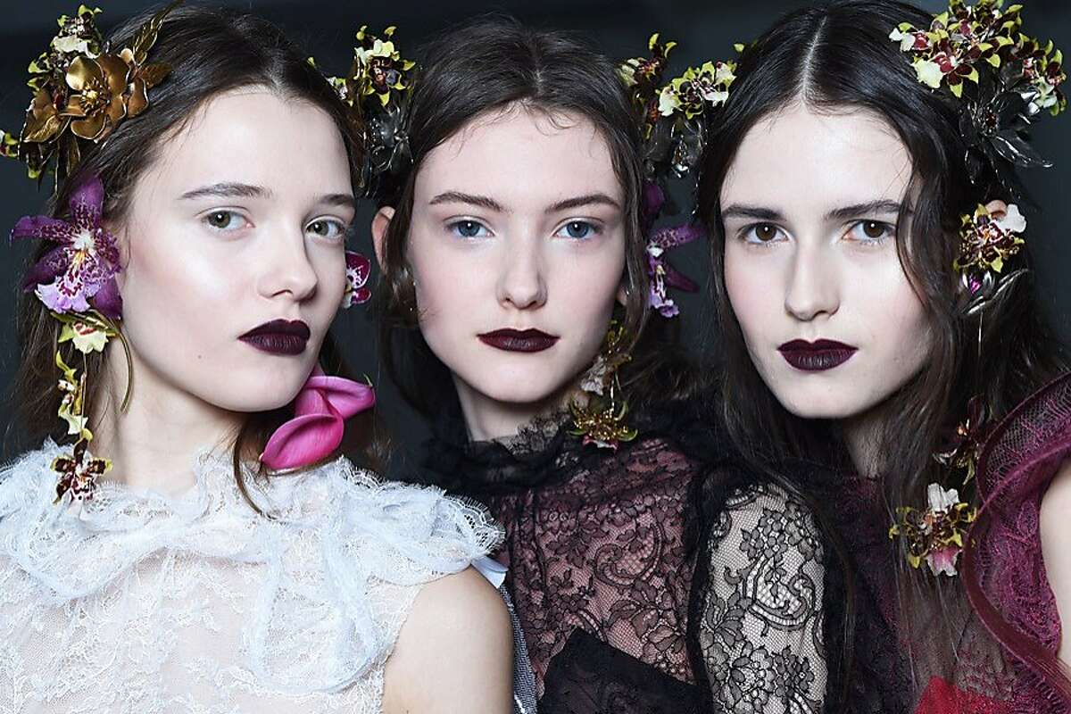 At Rodarte, James Kaliardos (for Nars Cosmetics) made the models look like rebellious woodland nymphs. The skin was otherwordly and bright while the lips were stained a deep plum via Liv Audacious Lipstick and Train Bleu Velvet Matte Pencil, and the eyebrows were tinted black from mascara.