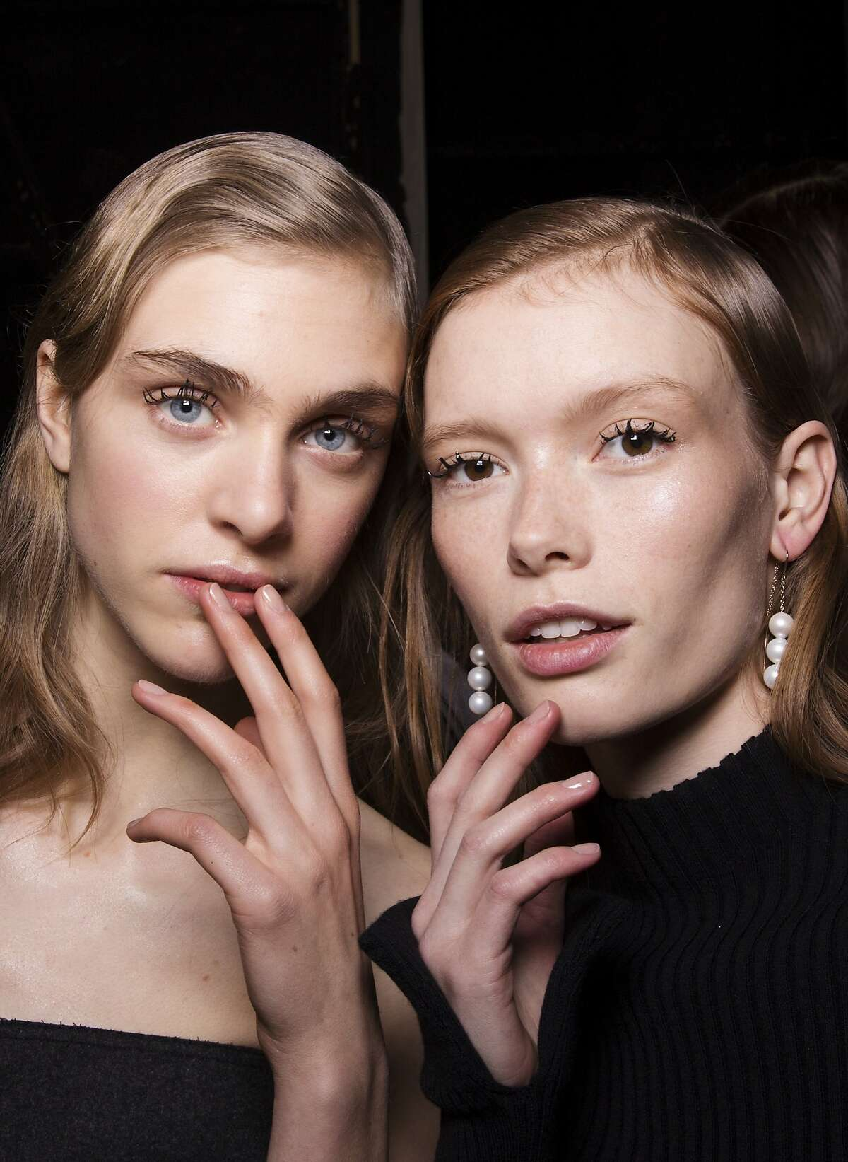 To balance the clumpy tarantula lashes on the models at Jason Wu, Deborah Lippmann used her taupe creme Fashion polish to give the models subdued nude nails.