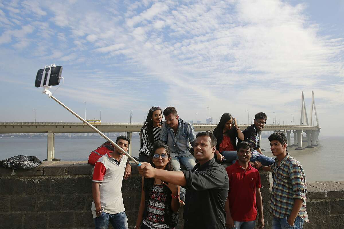 In this Feb. 22, 2016, photo, Indians take a selfie in Mumbai's coastline. India is home to the highest number of people who have died while taking photos of themselves, with 19 of the world's 49 recorded selfie-linked deaths since 2014, according to San Francisco-based data service provider Priceonomics. The statistic may in part be due to India's sheer size, with 1.25 billion citizens and one of the world's fastest-growing smartphone markets.