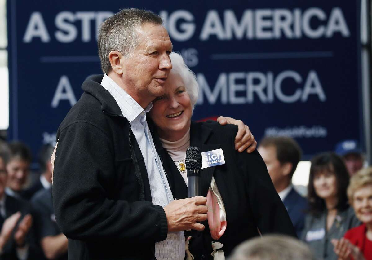 Republican presidential candidate, Ohio Gov. John Kasich hugs Barbara Hudson, wife of State Sen. Billy Hudson, R-Hattiesburg, who with her husband endorsed Kasich during a town hall meeting in Gulfport, Miss., Wednesday, Feb. 24, 2016.