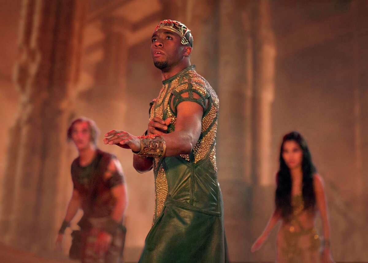 """This image released by Lionsgate shows Chadwick Boseman in a scene from """"Gods of Egypt."""" (Lisa Tomasetti/Lionsgate via AP)"""