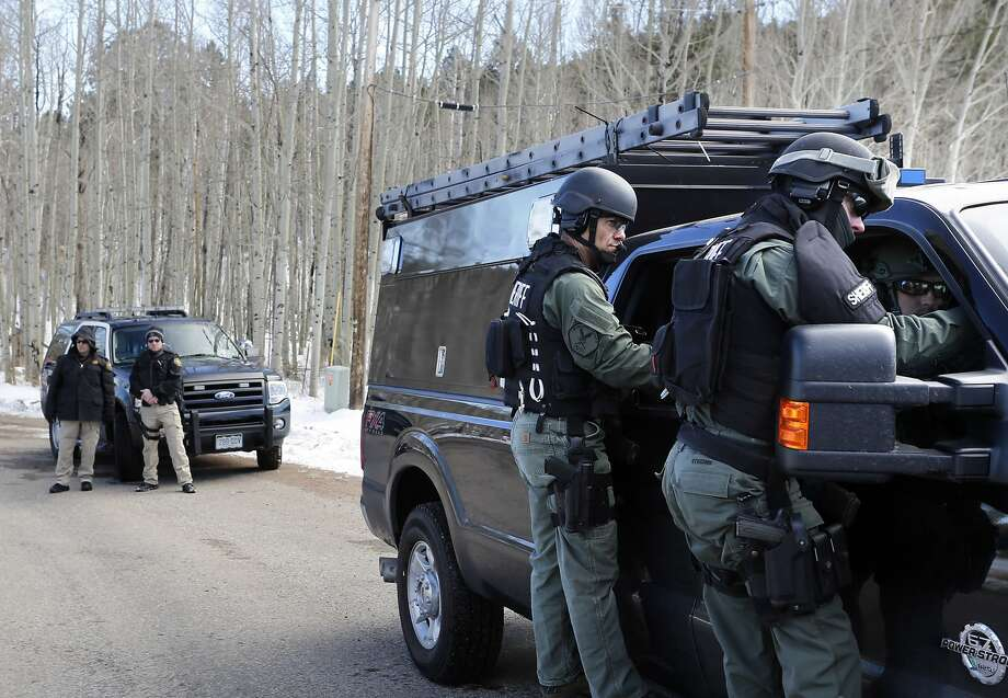 Jefferson County SWAT officers work at the scene where a 58-year-old man opened fire on three sheriff's deputies trying to serve him with an eviction order in Bailey, Colo. Photo: Brennan Linsley, Associated Press