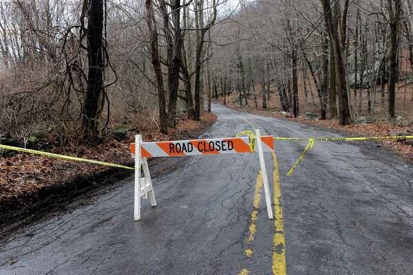 Long Mountain Road in New Milford is closed Thursday morning, February 25, 2016, because of overnight storm damage.