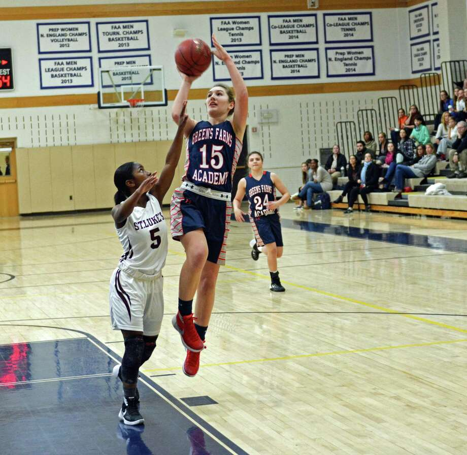 GFA's junior captain Lexi Kimball (No. 15) goes up for a jumpshot against a St. Luke's defender. Kimball had 36 points and four assists in the loss to St. Luke's. Photo: Contributed Photo / Westport News Contributed