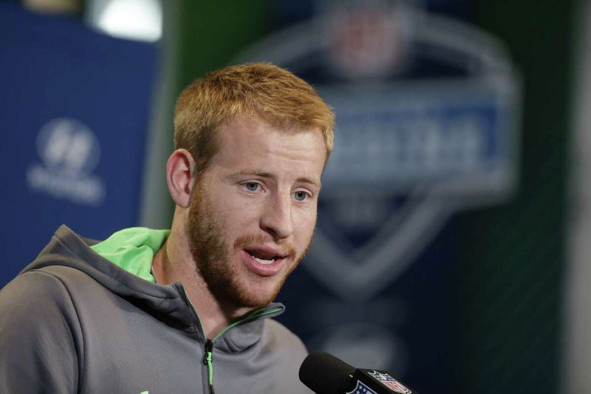 North Dakota St. quarterback Carson Wentz responds to a question during a news conference at the NFL football scouting combine Thursday, Feb. 25, 2016, in Indianapolis. (AP Photo/Darron Cummings)